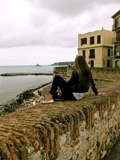sitting in the wall in antibes.. small, french, very romantic town :)