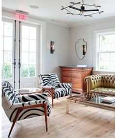 zebra chairs + chesterfield--cool look.