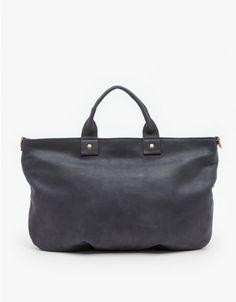 Fine Nubuck messenger tote bag from Clare Vivier. Features zip-up top, interior zip pocket, and detachable shoulder strap.
