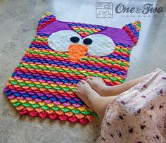 Crocheted Colorful_owl_rug_04_small2 - by Carolina Guzman on Ravelry - cost of pattern US$5.50. Knitted in Red Heart  Anne Geddes Baby Solids 8 ply/DK - 4mm hook. Yarn used is very soft and lovely to walk on and the yarn has a very wide range of colours.