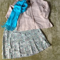 Sigrid Olsen Silk Skirt fun, flirty 🎉2X HP🎉 🎉2xHP🎉Light silk, fully lined skirt by designer Sigrid Olsen. Three ruffles at bottom created by shorter top skirt layer over light turquoise lining that has the bottom two ruffles. Falls beautifully at or below the knee. Lovely pattern of light turquoise, pale green, cream, black and sandy beige. Hidden side zip. Like new - worn only once or twice! Pairs well with Rafaella blouse and tank I've listed - check out my closet for them! Smoke free…