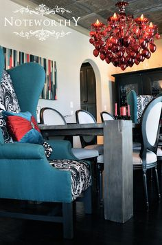 red chandelier, custom barn wood table, turquoise captains chairs