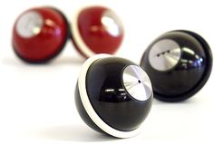 These salt & pepper shakers are made from bakelite and stainless steel, with silicone rubber rings that keep the balls from rolling away. Sleek, modern, and whimsical.