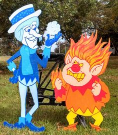 Snow Miser and Heat Miser Christmas yard decorations yard art. Miser brothers Snow Miser and Heat Mi Outside Christmas Decorations, Christmas Yard Art, Christmas Wood, Christmas Projects, Christmas Lights, Christmas Ornaments, Christmas Ideas, Hall Decorations, Yard Ornaments