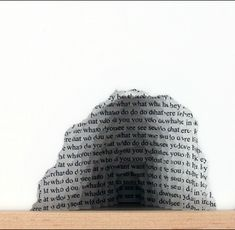 """Scott Hazard puts two and two together in his carefully constructed works—Photo Constructs and Text Constructs. Each piece is made by layering pages or images, which are then torn with concentric holes that add texture and depth.   Scott's goal is to ultimately """"draw the viewer in for momentary reflection and a temporary departure""""."""