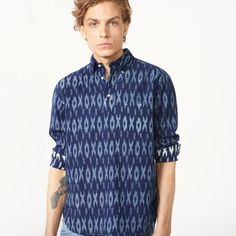 Our Indigo Pullover Shirt, in 100% cotton with indigo-dyed yarns, features an easy fit that's perfect for slipping on, a striking tribal print inspired by a traditional ikat weave, button-down collar, a single chest pocket and a signature box pleat with locker loop at the back.