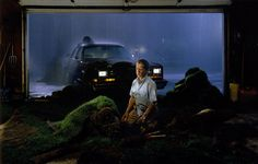 Gregory Crewdson is one of the today's most influential contemporary photographers. His elaborately staged photographs are the equivalent of big-budget Hollywood films, with a consistent narrative thread on small-town suburban life. The Brooklyn-born photographer's work is ambitious in scope and scale. The dramatic depiction of the dark-side beneath American beauty has earned him many accolades throughout his career. He has even had the opportunity to 'direct' thespians like T...