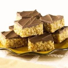 Scotcheroos. Chewy, crispy peanut butter bars are spread with chocolate and butterscotch for a new family favorite treat.