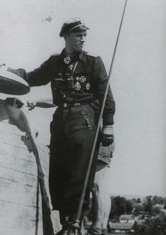 SS-Obersturmführer Willi Hein poses beside the turret of his Panther tank just after receiving the Knight's Cross on 4 May 1944 while he was a staff officer in 2nd Company of a Panzer Regiment in 5th SS Panzer Division Wiking.