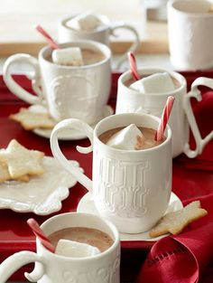 hot chocolate with homemade marshmellos and peppermint stick stirs