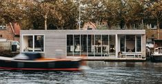 Solar-powered floating villa creates modern retreat in historic area  ||  This energy-neutral houseboat is surprisingly airy and bright. https://www.curbed.com/2018/2/16/17018552/modern-houseboat-floating-home-vanommeren-architecten-haarlem?utm_campaign=crowdfire&utm_content=crowdfire&utm_medium=social&utm_source=pinterest