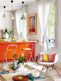another view, orange kitchen  like the doors & curtains