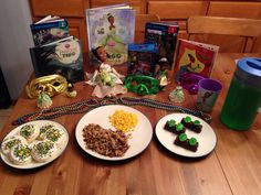 Princess and the Frog Dinner - Tiana's dirty rice (chicken and cheesy rice for my daughter), Ray's corn, Mama Odie's swamp juice (green kool aid), Prince Naveen and Tiana frogs on a log (haribo gummy frogs and hohos) and Mardi Gras cookies - Princess and the Frog Movie Night - Disney Movie Night - Family Movie Night