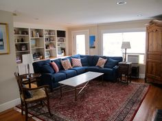 I love this blue sofa with the red persian rug.  Living room done!