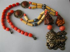 A coral glass and enamel necklace made in China during the 1960's - 80's.