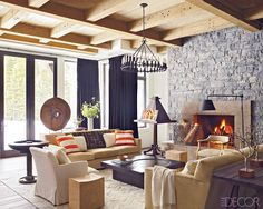 A Ray Booth-Designed Ski Lodge - ELLE DECOR-In the family room, the light fixture is by Dessin Fournir, the sofas are by Stewart Furniture, and the lectern is antique.