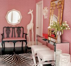 Pink, gloss floors, zebra, an owl, mirrored furniture and gold accents...yes, it's a lot but it works!