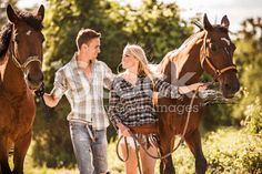 Smiling couple with horses. royalty-free stock photo