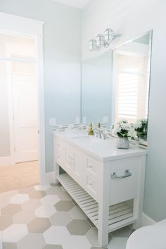 Light Blue Bathroom With Large Honeycomb Floor Tiles Millhaven Homes