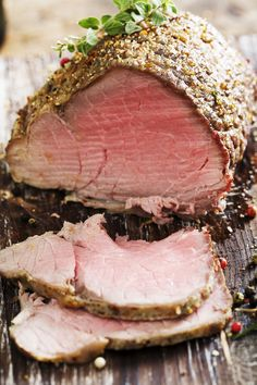 Photo about Sliced rare beef, roast covered in pepper and herbs. Image of sirloin, cooked, roast - 3957295 Sirloin Tip Roast, Sirloin Tips, Beef Tenderloin, Topside Beef, Roast Beef Recipes, Recipe Images, Sous Vide, Favorite Recipes, Herbs