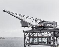 arcgency's luxurious krane retreat suspends over the nordhavn harbor in denmark