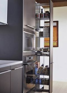 Pullout Kitchen Storage Ideas Great idea for the empty space between fridge and wall!