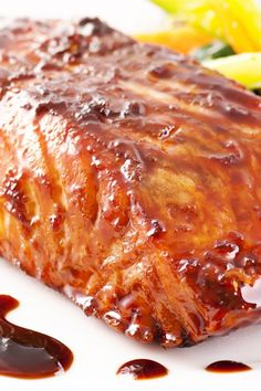 Maple Glazed Salmon Recipe including course(s): Entrée; and ingredients: corn starch, ginger, maple syrup, salmon fillet, scallion, sliced almond, soy sauce, water