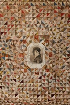 The Wales Museum Quilt Collection - A quilt made from a range of printed cottons. The central panel contains a portrait of Caroline of Brunswick, consort of King George IV. Made in Brecon in about 1820.