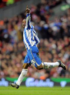 Kaz Lualua celebrates his goal at Anfield