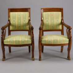 """Pair French Empire Mahogany and Parcel Gilt Chairs --- Circa 1830, this pair of ornately carved armchairs features swan details on the arm supports and front legs, with gilded wings. ---  Arm Height:  25.5"""" ---  Seat Height:  17.25"""" ---  Seat Depth:  19.5"""" ---  Item: 2920 --- Retail Price:   $6995"""