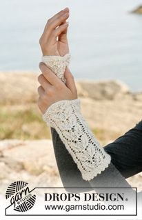 "Knitted DROPS scarf and wrist warmers with lace pattern in ""Baby Alpaca Silk"". ~ DROPS Design"