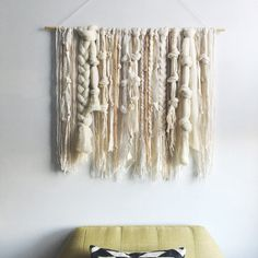 This is a made-to-order handmade wall hanging made from natural un-dyed roving and neutral-toned yarns and fibers.  Measurements: 36x30 inches It makes a beautiful gift for a housewarming, birthday, holidays, or wedding.   This wall hanging is made-to-order (~2 weeks), and comes with the dowel, ready to hang. Please contact me with any questions.