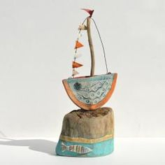 little boat sculpture - driftwood art Shirley Vauvelle http://www.coastalhome.co.uk/driftwood/driftwood-art.html