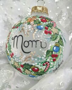 A special ornament for Mom! This festive Wreath is trimmed. with Christmas fun. A Gingerbread Man, Candy Canes, Stars, and Ornaments. Ive painted this 3 1/4 inch frosted glass ornament with acrylic paint and added a little glitter here and there for frosty sparkle. If youd like an inscription, theres no extra charge. This lovely keepsake will come in a nice box suitable for giving and will be packed securely for shipping. Thanks for visiting my shop, stop back soon
