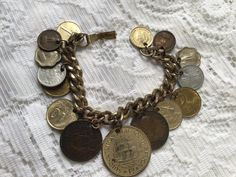 Coin charm bracelet 1960's by VINTAGEwithaSMILE on Etsy