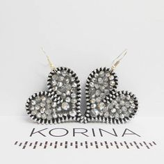 Silver heart earrings  These elegant earrings are made of aluminium zipper and silver glass beads which are all sewn by hand. The back of earrings is genuine leather.  Lenght including earring hook: 2.2 in (5.5 cm) Dimensions: 1.4 x 1.6 in (3.5 x 4 cm)   If you have any questions about
