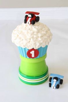 Giant cupcake with race cars. Base is made from blue chocolate wafers. http://www.facebook.com/sweetslice.ca