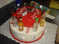 21st Birthday Cake: The birthday boy plays baseball and was turning 21, so the bottom layer is a baseball, and then the cards, liquor bottles and dice were just part of the