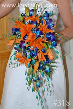 Orange lilies and blue orchid cascade bouquet from Gatlinburg's Little Log Wedding Chapel at www.logchapel.com Cheri,I think your first instinct for tiger lillies and peacock feathers were right, what if the wispy little trailing buds were peacock feathers? I think this is the one I like the best.