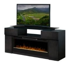 Now available at Palm Fan Store, the Concord electric fireplace media console by Dimplex. This media center features a huge firebox with a modern crushed glass ember bed. Best selection, best prices on Dimplex.