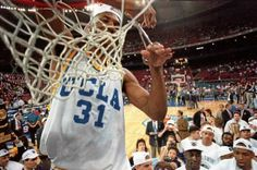 3 APR 1995: UCLA FORWARD ED O''BANNON CUTS DOWN THE NET AFTER THEIR 89-78 VICTORY OVER ARKANSAS IN THE NCAA FINAL AT THE KINGDOME IN SEATTLE, WASHINGTON. O''BANNON WAS NAMED PLAYER OF THE TOURNAMENT. Mandatory Credit: Allsport USA/ALLSPORT