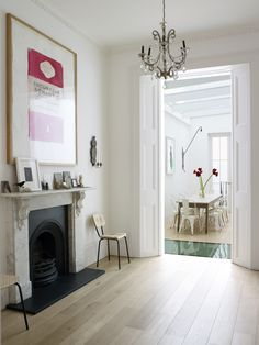 Harriet Anstruther's bright and modern 1840s London town house. A glass insert in the dining-area floor sends light down to Bourne's basement-level studio, which opens onto a garden courtyard.