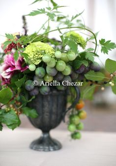 Wicked awesome cherry tomatoes in a centerpiece; fresh produce plays a role in our arrangements. By Ariella Chezar