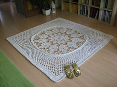 My new carpet - it measures 170x170 cm and used up 1100 meters (about 5 kilos) of cotton twine (5 mm thick). I used a 9 mm crocheting hook and the whole work took me about 10 hours.