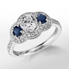 A gorgeous @m_lhuillier Three-Stone Halo Sapphire and Diamond Engagement Ring from @BlueNile
