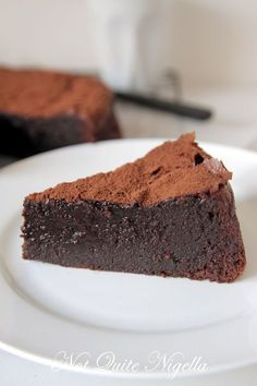 This is truly a one bowl cake and it is gooey, fudgey and moist inside. One thing though and that is do make sure that you use the best quality chocolate you can find. You could also make it gluten free by substituting the plain flour for a gluten free flour like chestnut flour.  The chocolate is certainly the star ingredient here and with a little shake of cocoa it will transform you into a moist chocolate cake bearing domestic goddess.