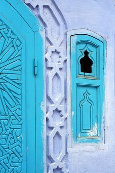 gorgeous shade of turquoise for door and windows