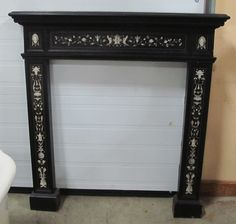 "aesthetic mantel DLTTAesthetic Mantel w/Figural Bone Inlay Overall 43"" w x 44"" h Firebox 28 3/4"" x 34 1/2"" MT-0009"