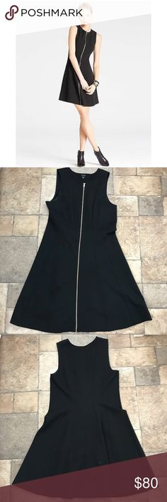 """Ann Taylor Ponte Zip Front Dress Gorgeous Ann Taylor Ponte Knit Zip-front dress. The perfect black dress! A-line shape. Gold zipper adds an elegant and sexy touch. Great for all occasions and seasons. Plus, it would be awesome for a mother!! High quality material. Size 8. 38"""" from shoulder to hem, 17"""" armpit to armpit. It's in excellent condition. From pet and smoke free home. Ann Taylor Dresses"""