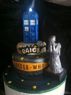 Doctor Who themed Birthday Cake -- I'll take the TARDIS, but I'll totally pass on the Weeping Angel, thanks!!